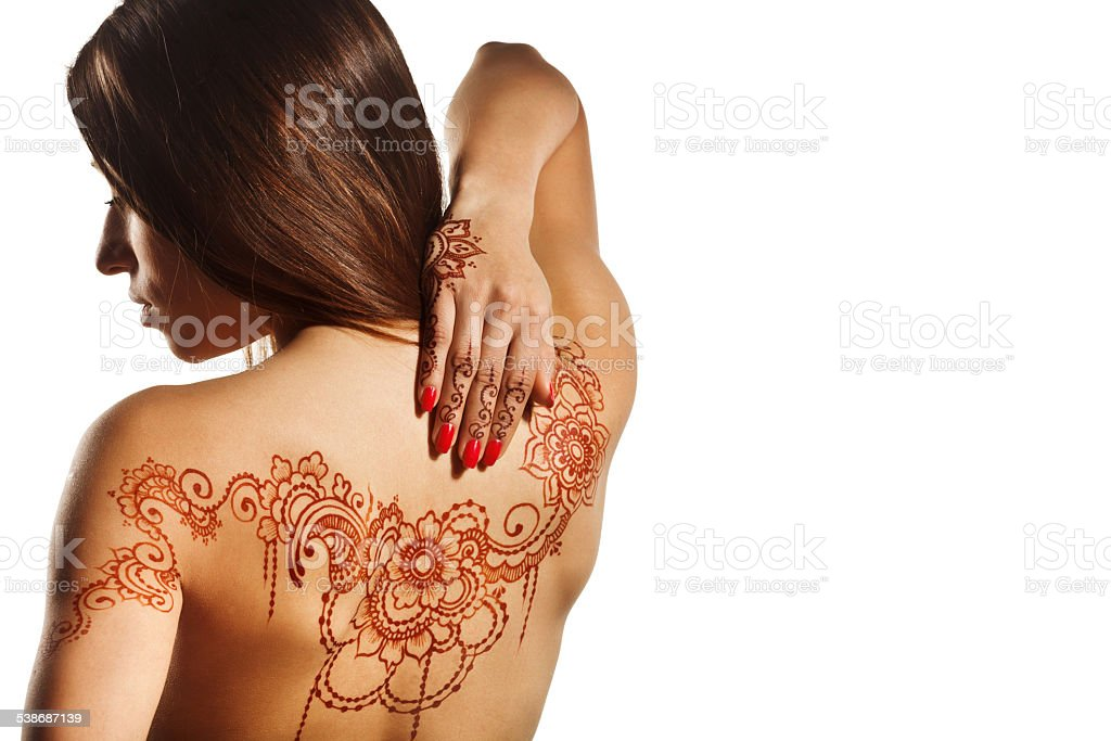 naked back of young girl with henna mehendi stock photo