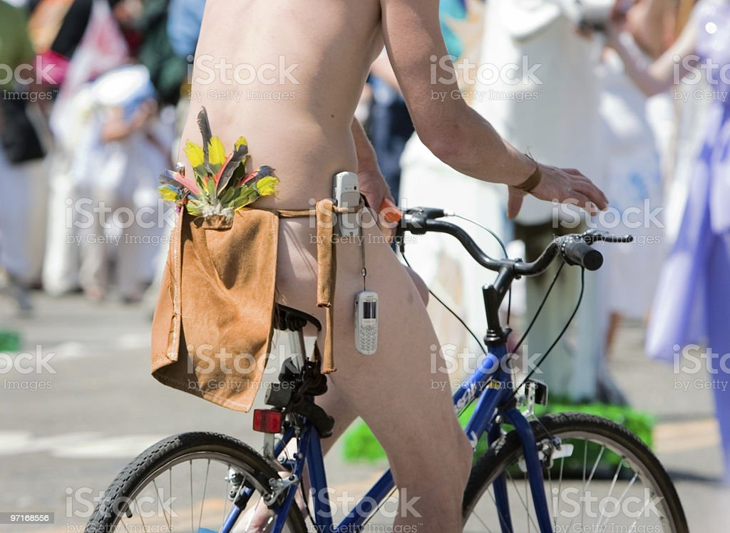 Naked bicyclist with cell phone royalty-free stock photo
