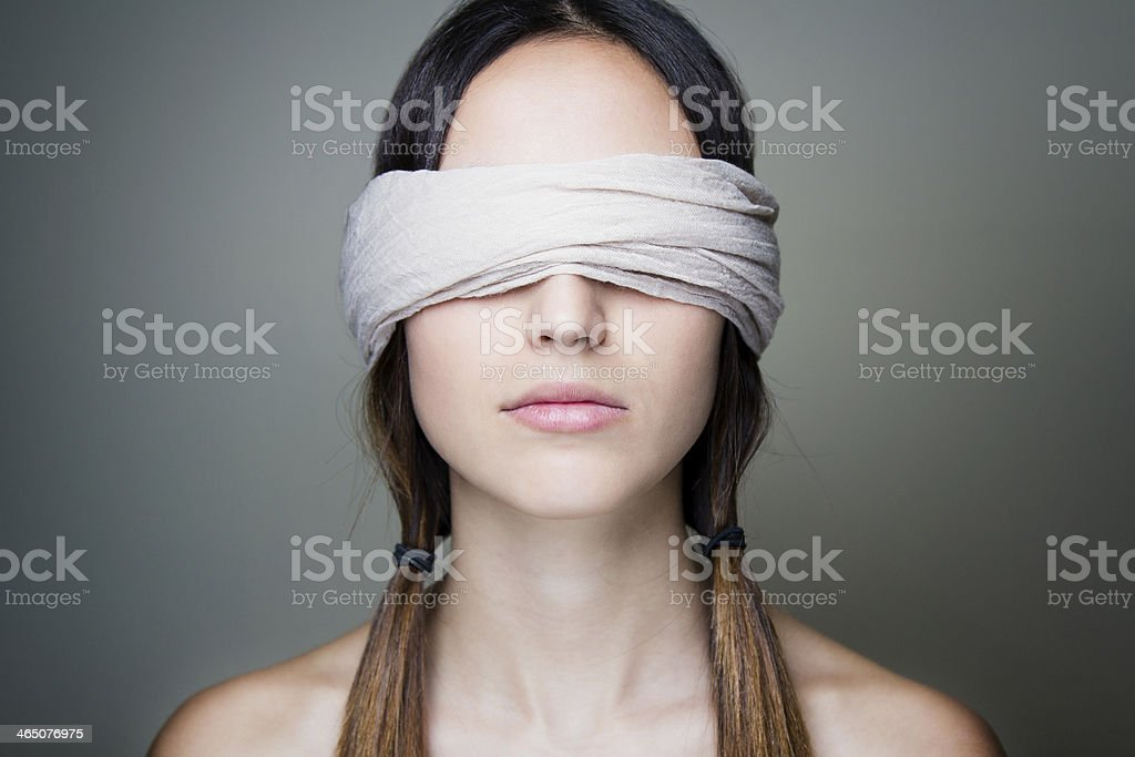 Naked blindfold woman stock photo