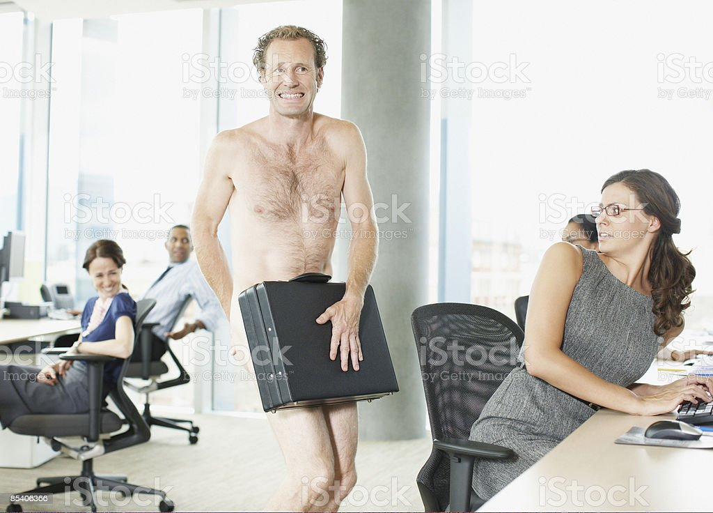 Naked businessman with briefcase in office stock photo