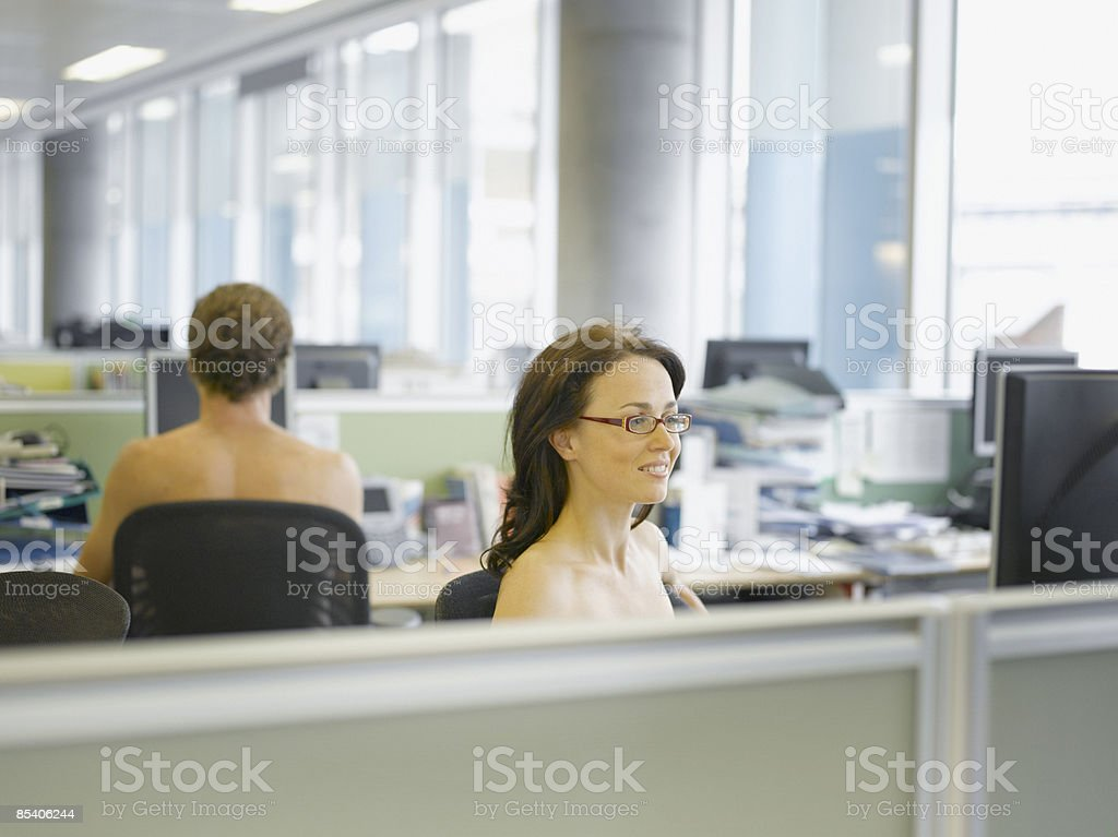 Naked businesspeople working in office royalty-free stock photo
