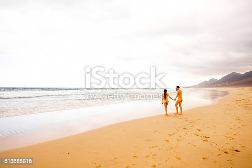 Naked Couple Walking On The Beach Stock Photo & More