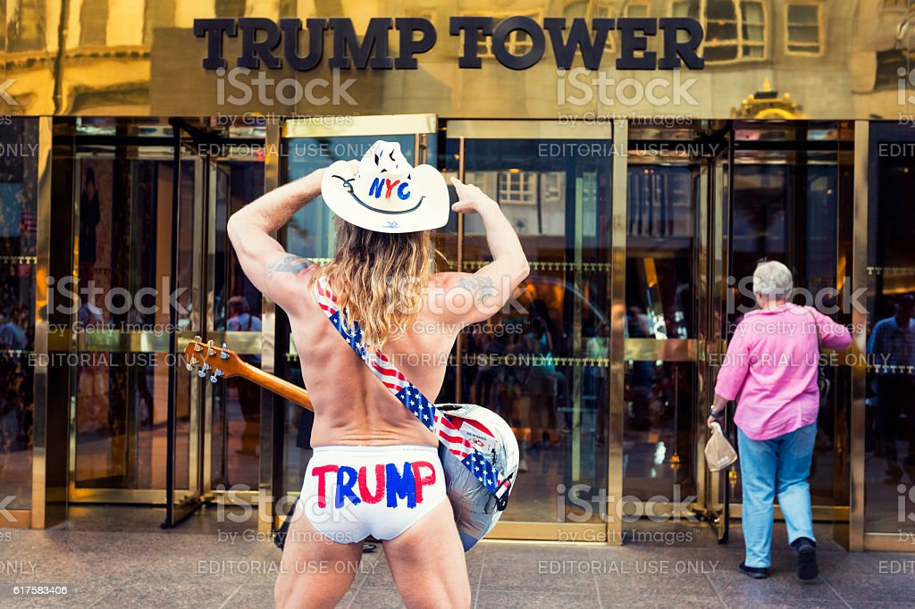Naked Cowboy in Front of the Trump Tower in NYC stock photo