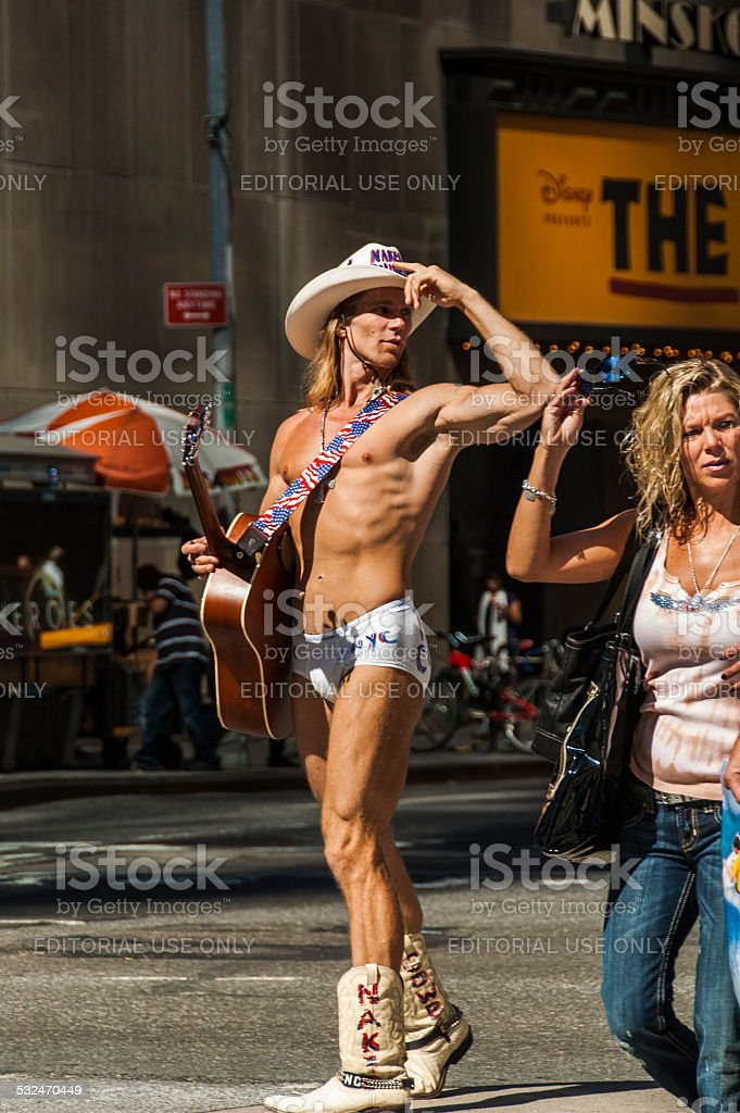 Naked cowboy stock photo
