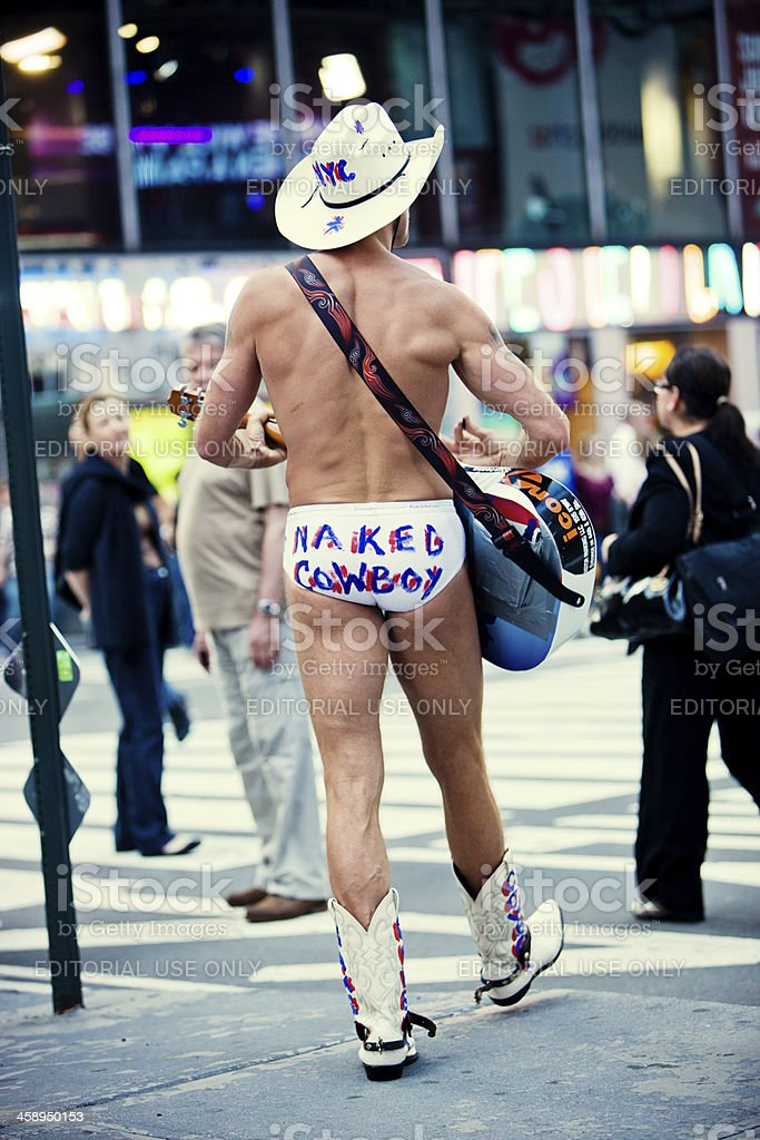 Naked Cowboy Playing Guitar On Times Square New York City