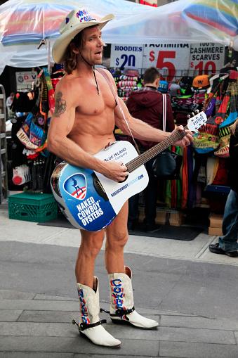 NEW YORK - CIRCA JULY 2013: Naked Cowboy Singing In Times