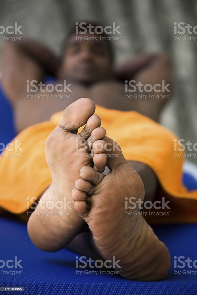 naked feet attached to hunk royalty-free stock photo