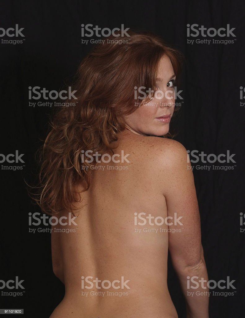 Naked female from behind royalty-free stock photo