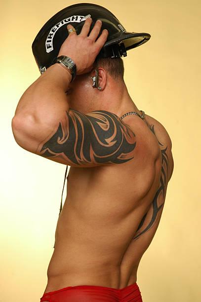 naked firefighter stock photo