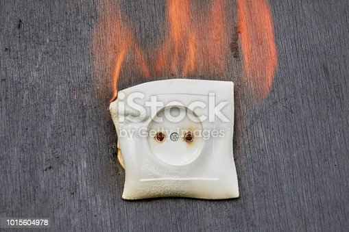istock Naked flame in premises, ignitions of socket in power supply. 1015604978