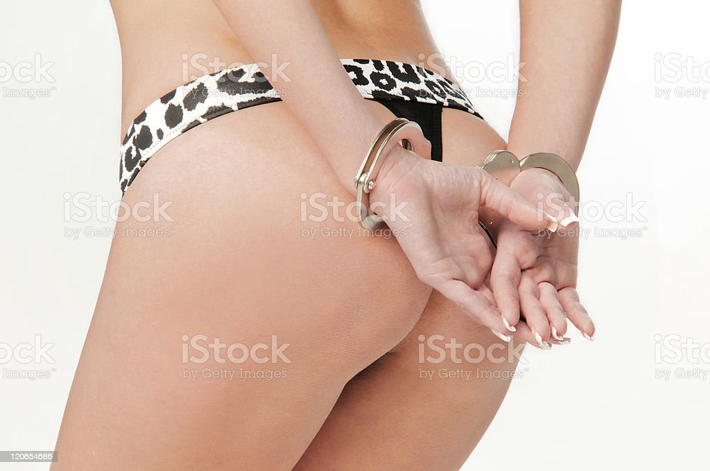 naked girl in handcuffs royalty-free stock photo