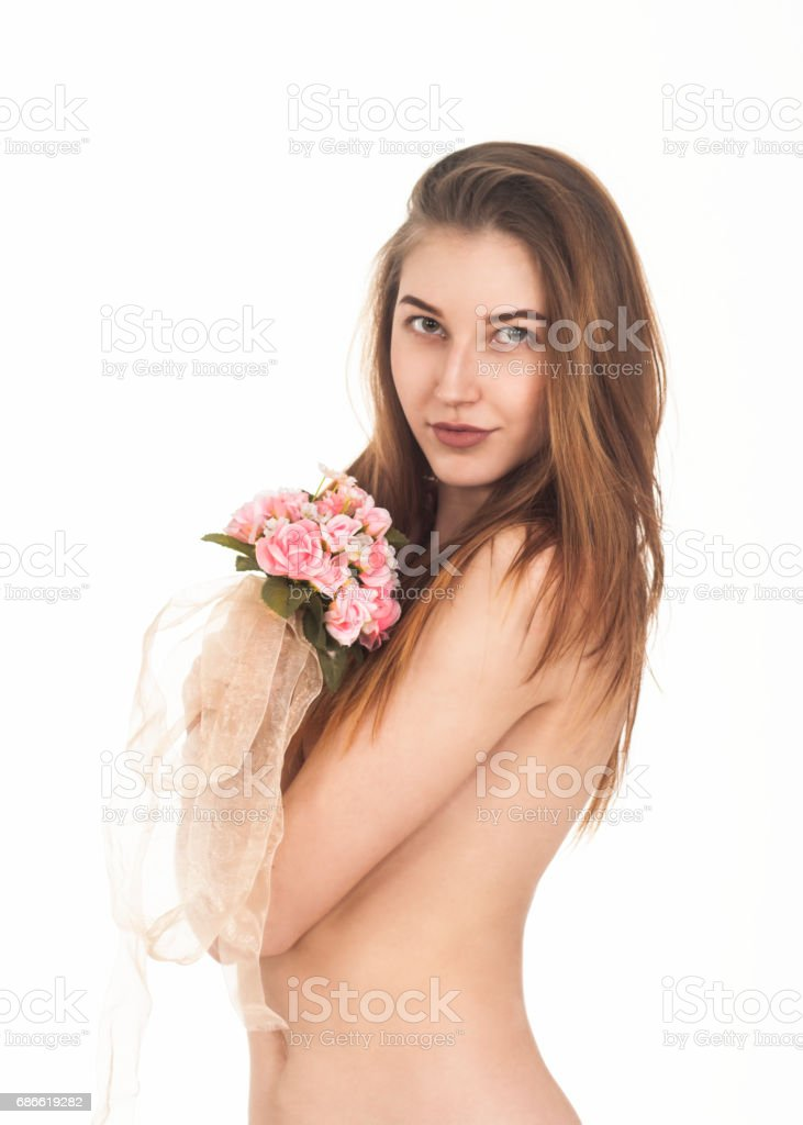 Naked girl with a bouquet. royalty-free stock photo