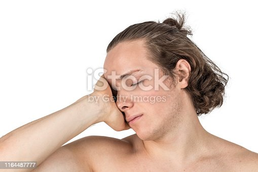 1134770826istockphoto Naked handsome young man combing his hair with hand on white background isolated 1164487777