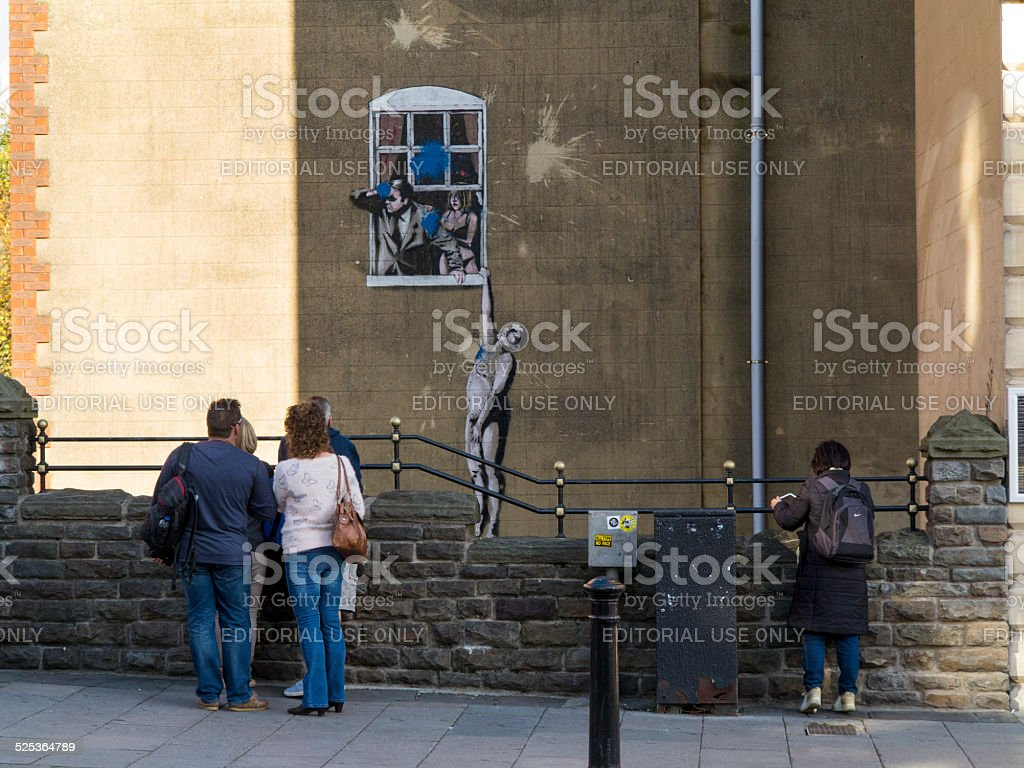 Naked Man - a Banksy artwork in Bristol stock photo