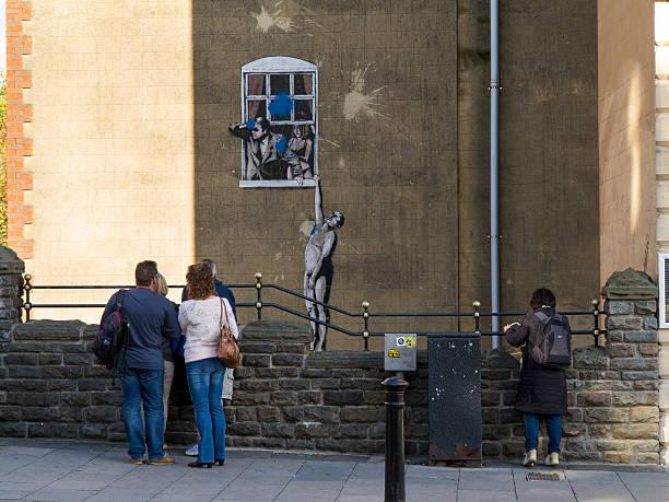Nudo uomo-Banksy opera in Bristol - foto stock