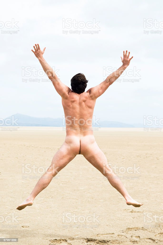Naked man jumping royalty-free stock photo