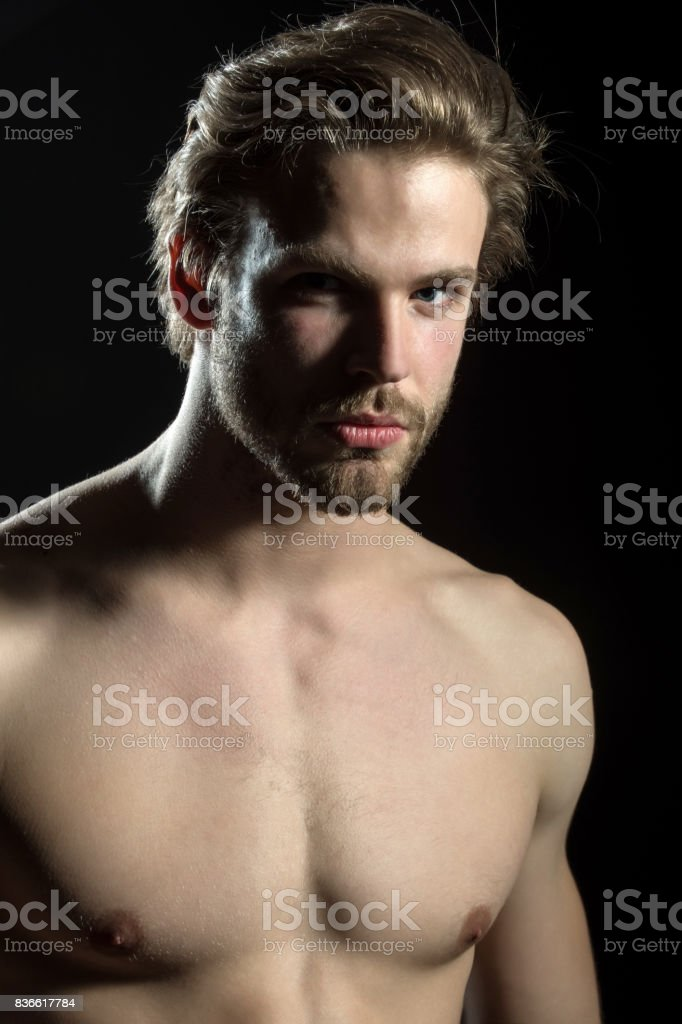 Naked Man Looking At The Camera On Black Background In The Studio Closeup Handsome Man