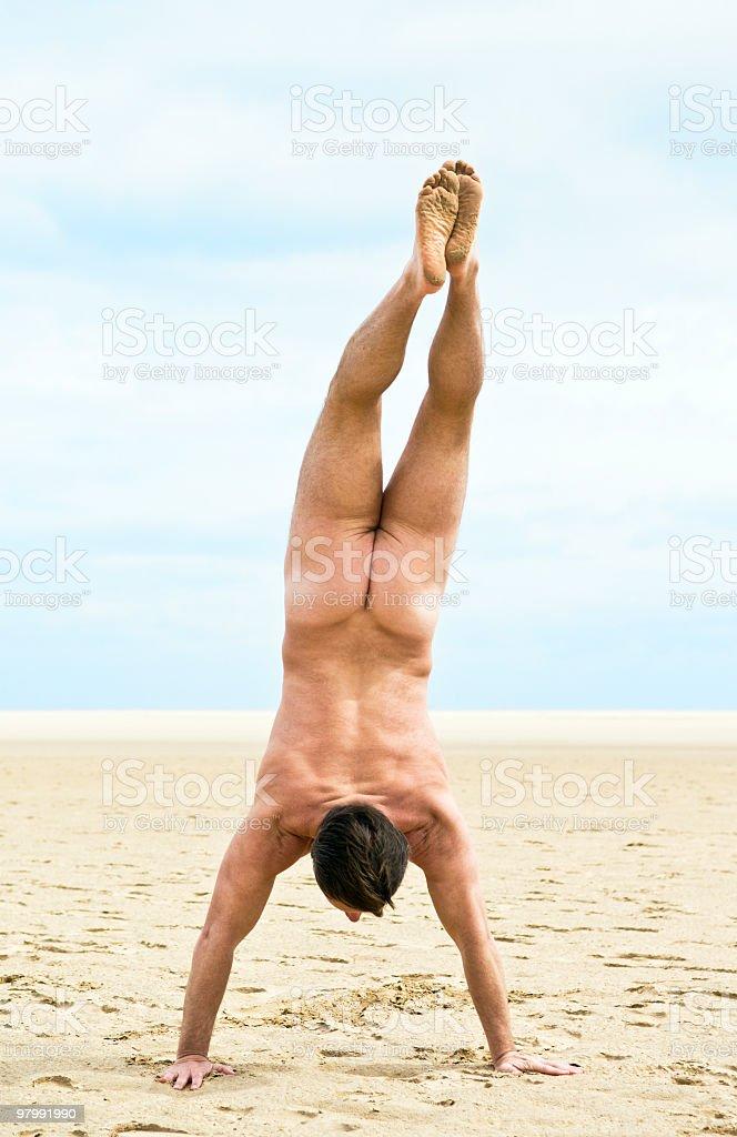 Naked man on beach. royalty-free stock photo
