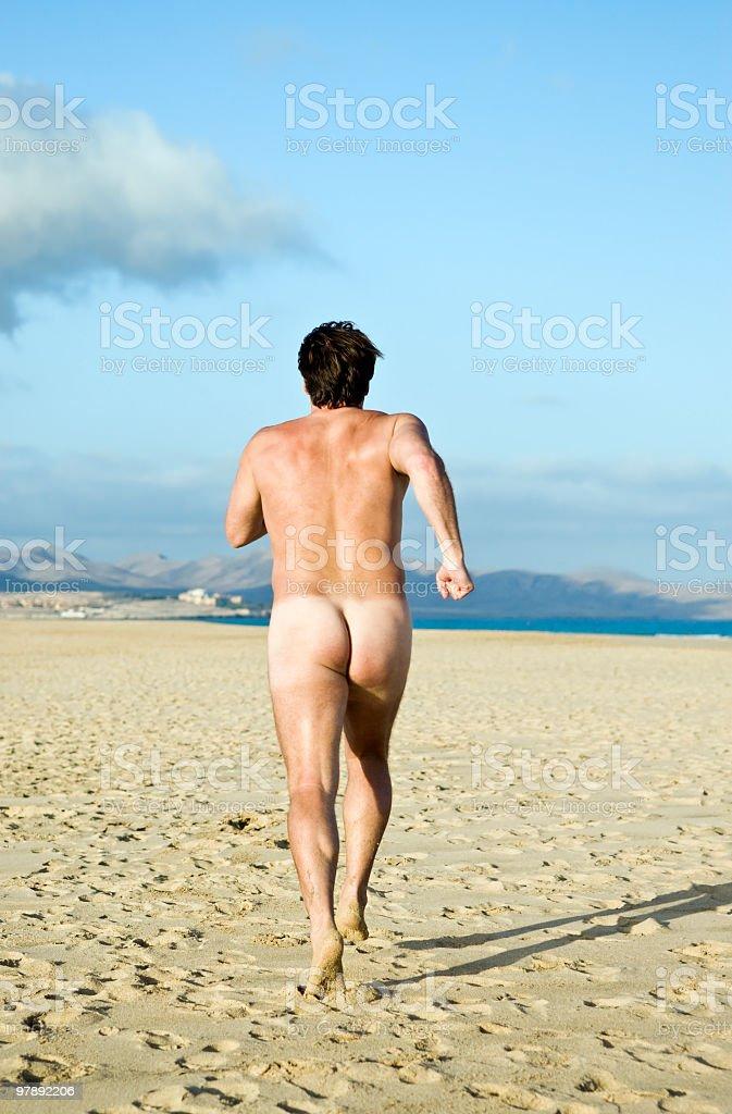 Naked man running. royalty-free stock photo
