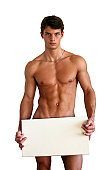 istock Naked Muscular Man Covering with Box Isolated on White 144368361