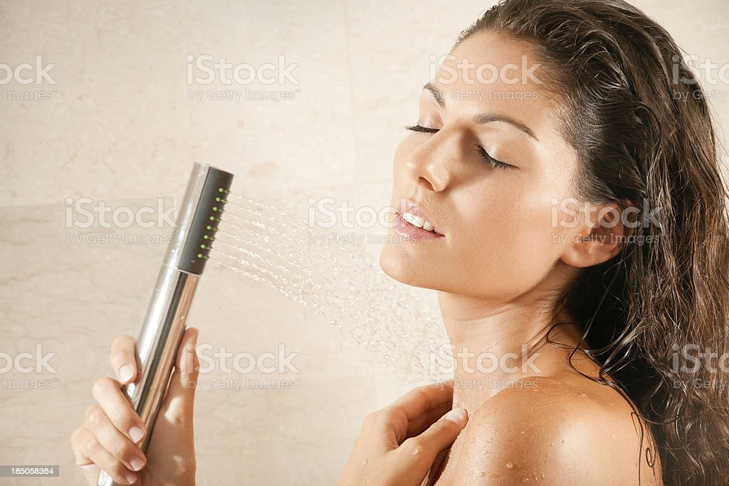 Naked natural beautiful Woman relaxing under a hot shower (XXXL) royalty-free stock photo