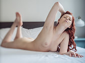 istock Naked on the bed 930505414