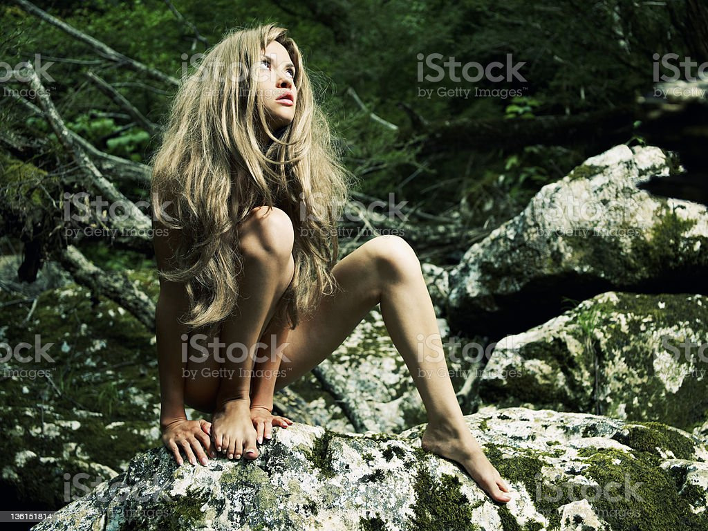Naked savage in the jungle stock photo