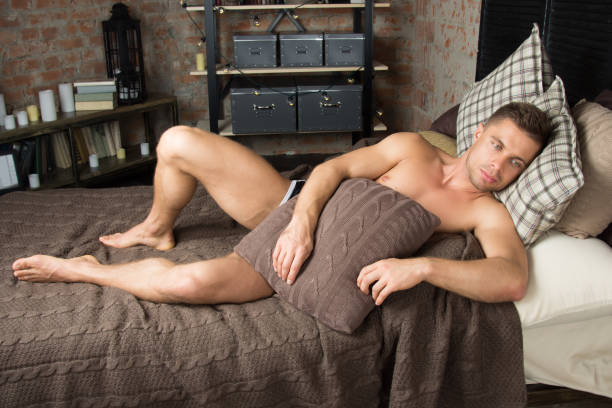 Naked men in bed — img 7