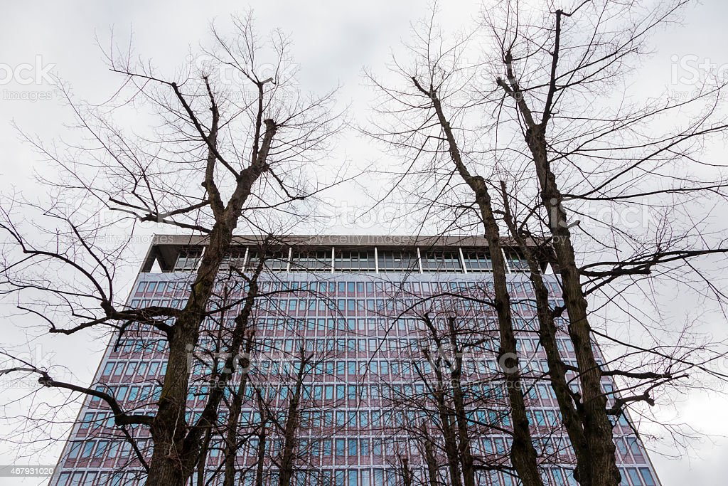 Naked trees in front of Former Norwegian government building stock photo