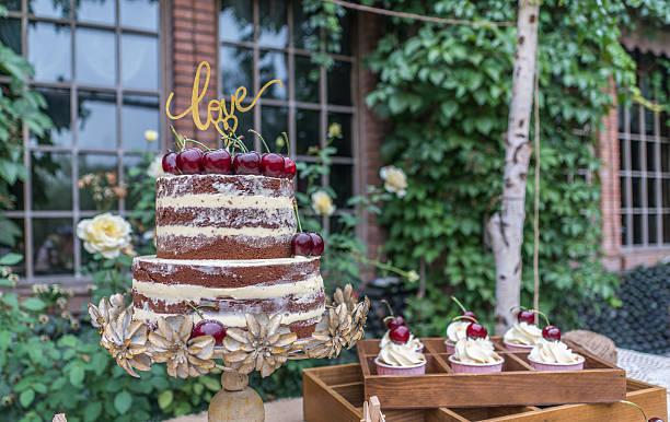 Naked wedding flower cherry cake stock photo