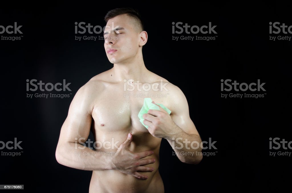 Naked wet bodybuilder. Sexy body. stock photo