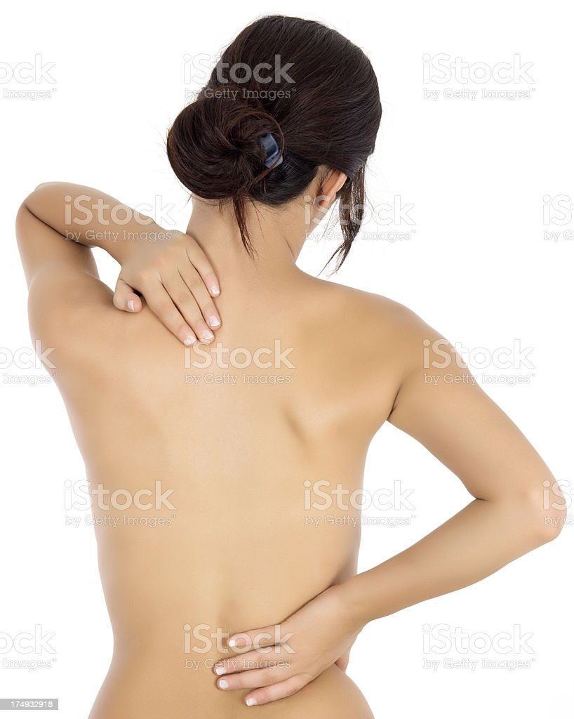 Naked woman back view with pain in her back royalty-free stock photo