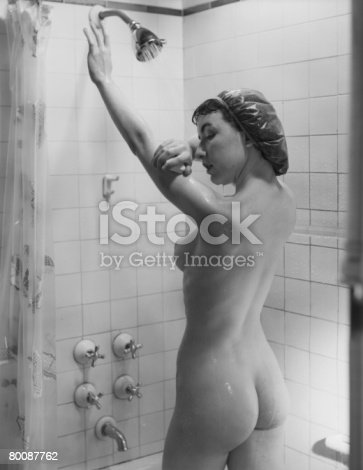 istock Naked woman showering, rear view 80087762
