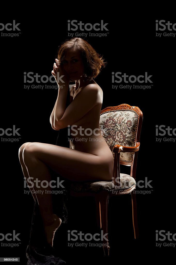 naked woman sitting on old chair royalty-free stock photo