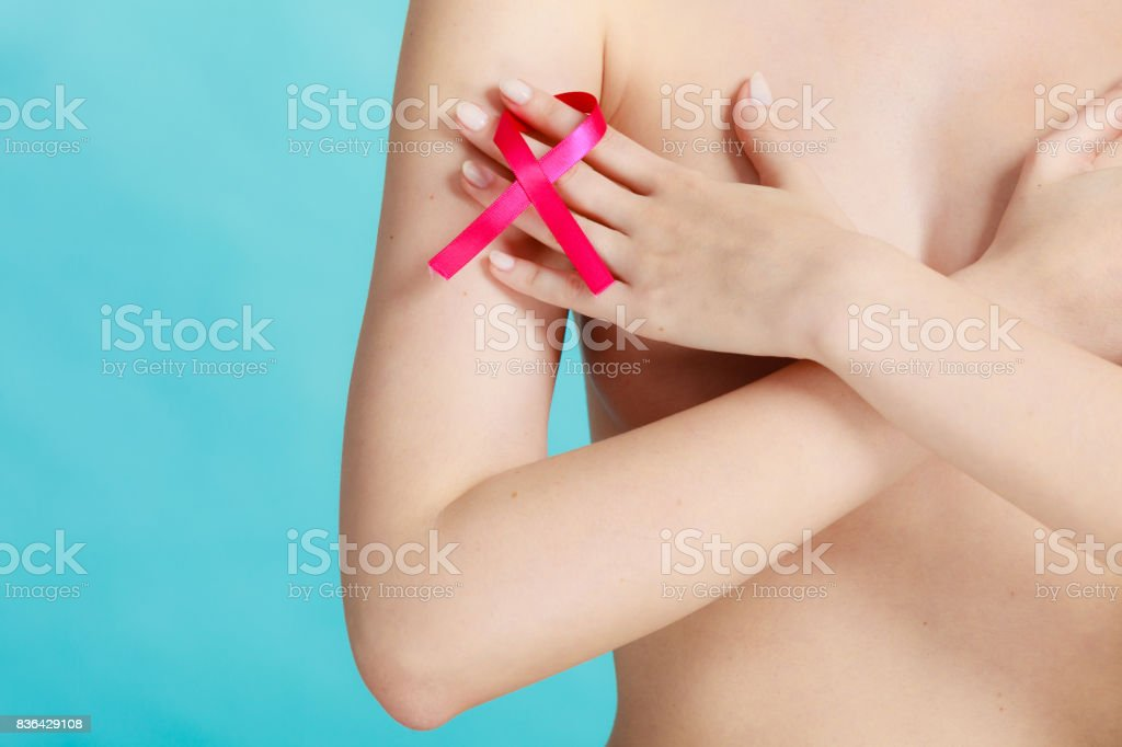 Naked woman with breast cancer awareness ribbon foto stock royalty-free