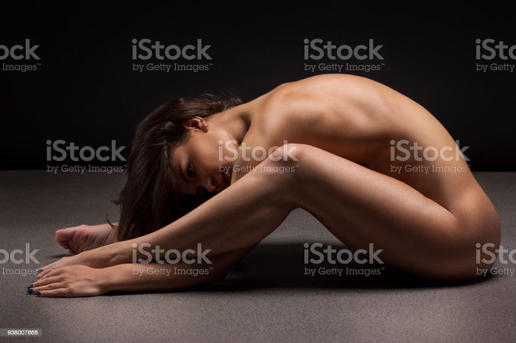 Fesses sensuelles nues isoles sur noir Image 35717688.