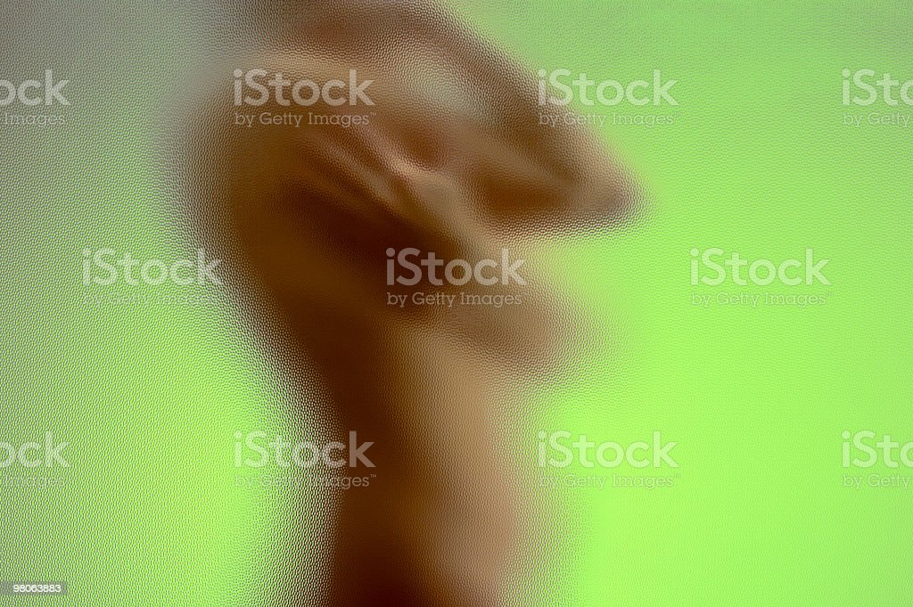 Naked woman's torso behind a glass, side view royalty-free stock photo