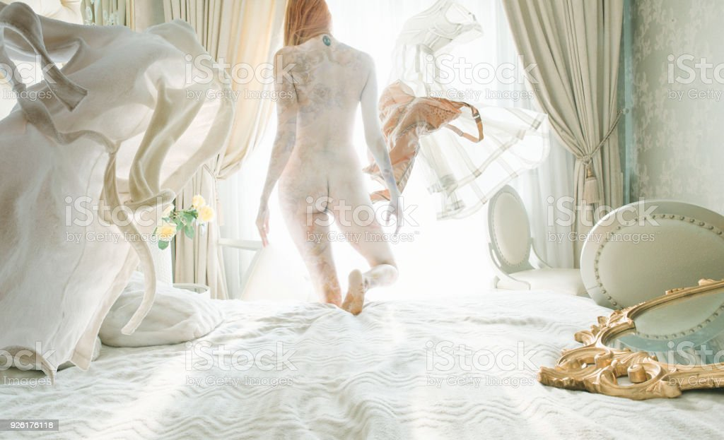 naked women with levitation clothes stock photo