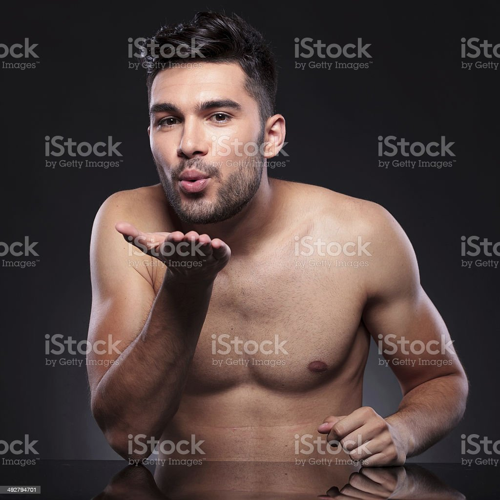 naked young man sends you a kiss stock photo & more pictures of