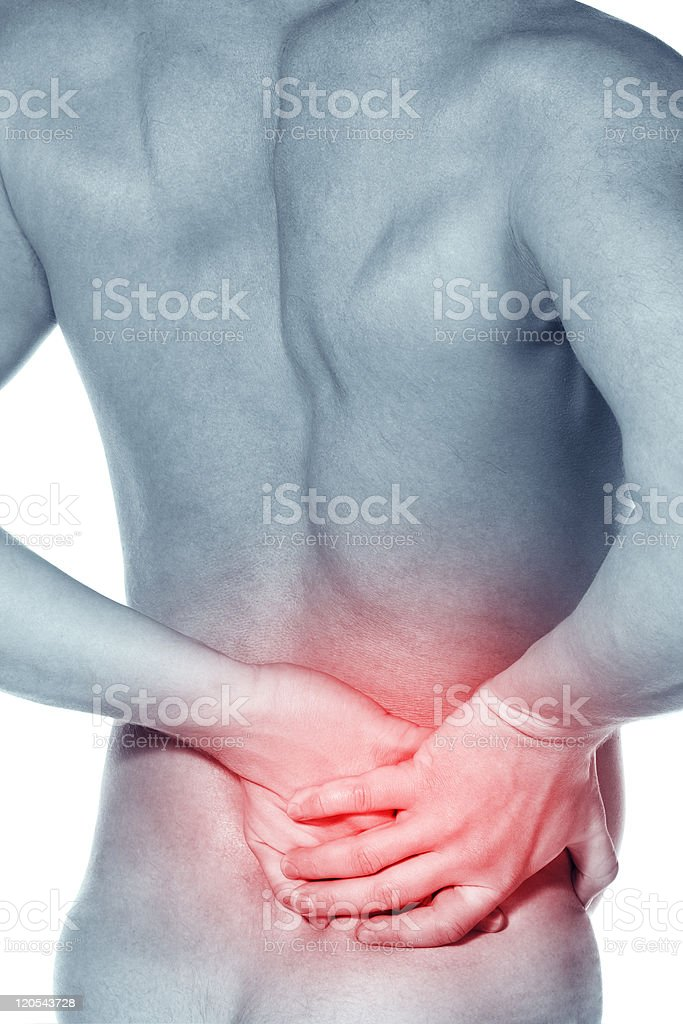 naked young man with  pain in a waist royalty-free stock photo
