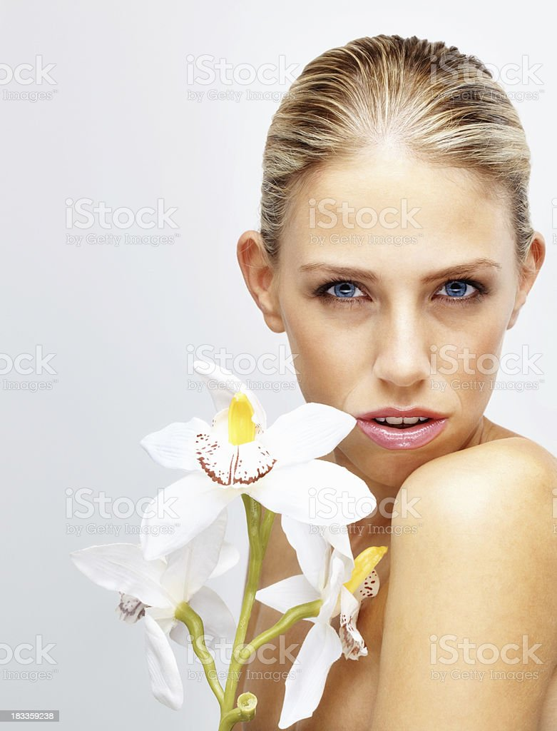 Naked young woman with flowers isolated on white royalty-free stock photo