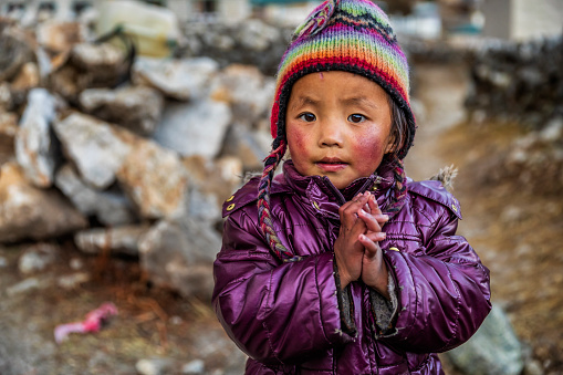 Tibetan little boy saying namaste, Mount Everest National Park. This is the highest national park in the world, with the entire park located above 3,000 m ( 9,700 ft). This park includes three peaks higher than 8,000 m, including Mt Everest. Therefore, most of the park area is very rugged and steep, with its terrain cut by deep rivers and glaciers.