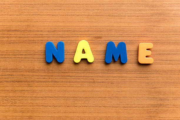 name  colorful word name colorful word on the wooden background alias stock pictures, royalty-free photos & images