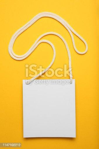 istock Name tag badge on yellow background, isolated convention card blank 1147102212