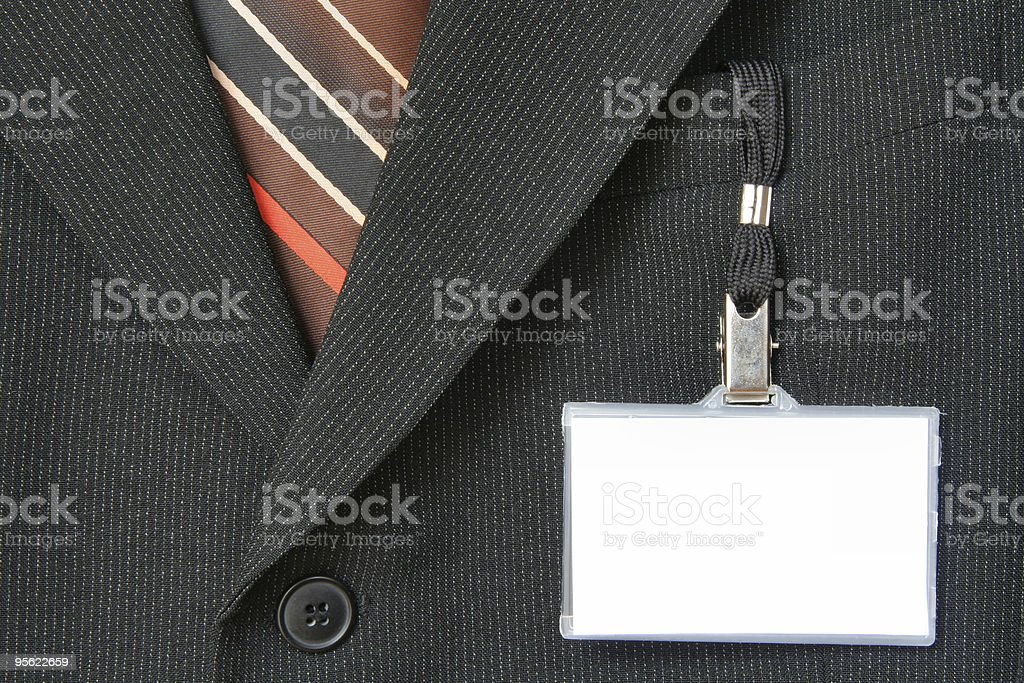 Name tag hanging from pocket of suit jacket royalty-free stock photo