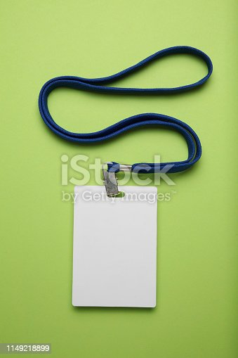 istock Name tag mockup isolated on green background. Plain empty badge id mock up hanging on neck with string 1149218899