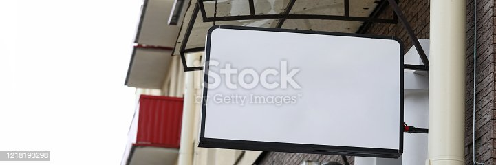 Close-up of sign with barbershop. Professional haircut and grooming. Saloon and beauty treatment for men. Plate with copy space for text or advertisement. Ad concept