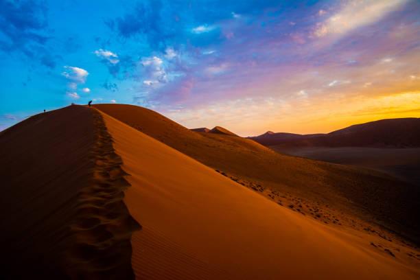 Namib Desert, Namibia, Africa Sunset glow in the Namib Desert. namib desert stock pictures, royalty-free photos & images