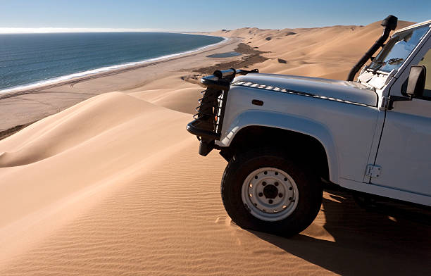 Namib Desert - Namibia Driving in the sand dunes of the Namib Desert near Sandwich Bay on the coast of Namibia namib desert stock pictures, royalty-free photos & images