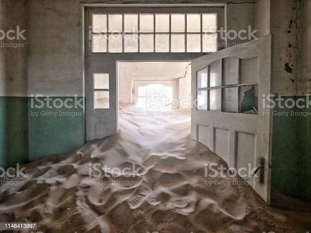 Namibia Ghost Town Abandoned Hospital Corridor Full Of Sand Stock Photo - Download Image Now